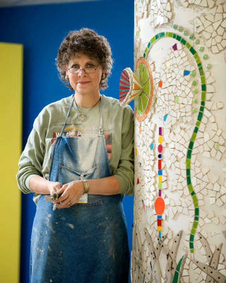 ARTIST: Morna Simon-McGuffey with her tiled column she created for Texas Children's Hospital West Campus. Photo: Allen S.Kramer TCH, COURTESY PHOTO