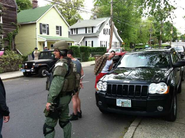 Federal agents raided a house early Thursday morning, May 12, 2011 in Stamford, Conn. and took at least two men into custody. Photo: John Nickerson / Stamford Advocate