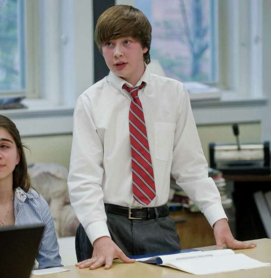 Evan O'Rourke, a seventh-grader at St. Peter School in Danbury, talks about his team's business, named Fashion Statement, which is a clothing store. Students worked in six teams to create businesses. Wednesday, May 11, 2011 Photo: Scott Mullin / The News-Times Freelance