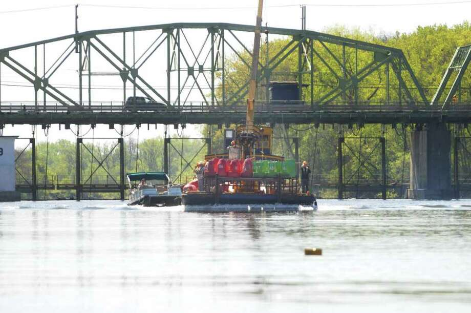 Self-propelled scow number 60 is loaded with buoys as it leaves Lock 9 on the Erie Canal on Thursday, May 12, 2011 in Glenville. (Paul Buckowski / Times Union) Photo: Paul Buckowski / 00013111A