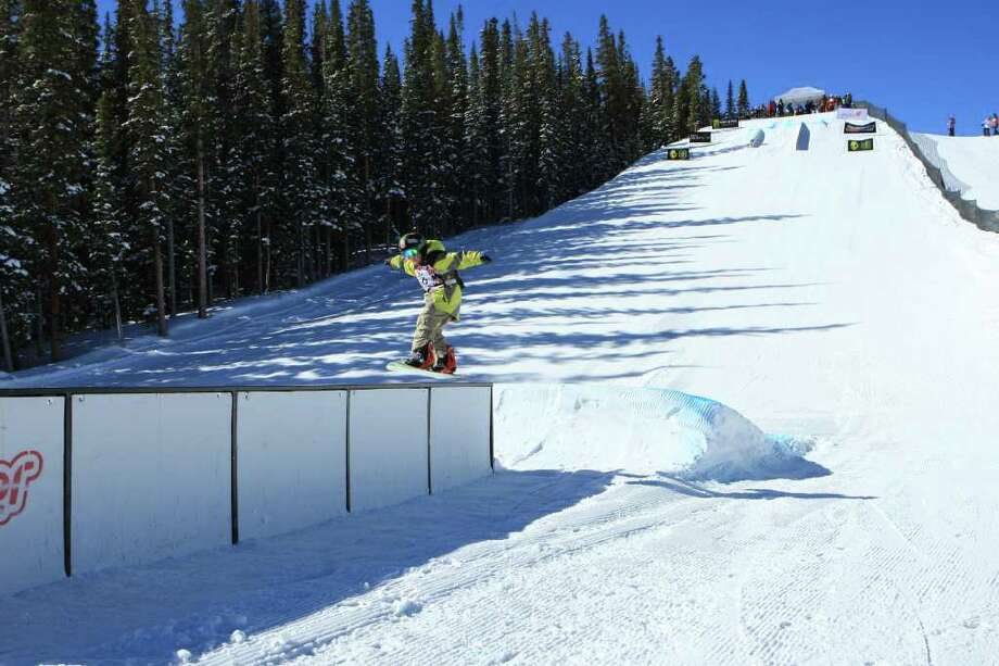 Fairfield-native TJ Fitzgerald rides during the boardercross event at the United States of America Snowaboard Association National Championships in Copper Mountain, Colo. Photo: Contributed Photo / Fairfield Citizen contributed