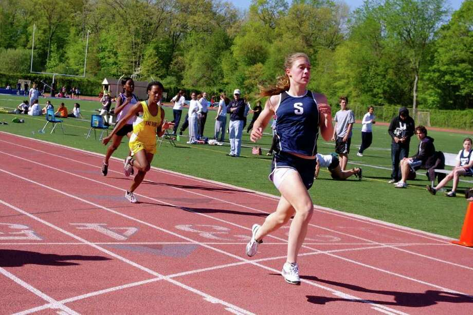 Staples sophomore Turner Block wins the 400 meters Monday in a tri-meet sweep over Trumbull and Westhill. Photo: Julia Friedman For The Westport News