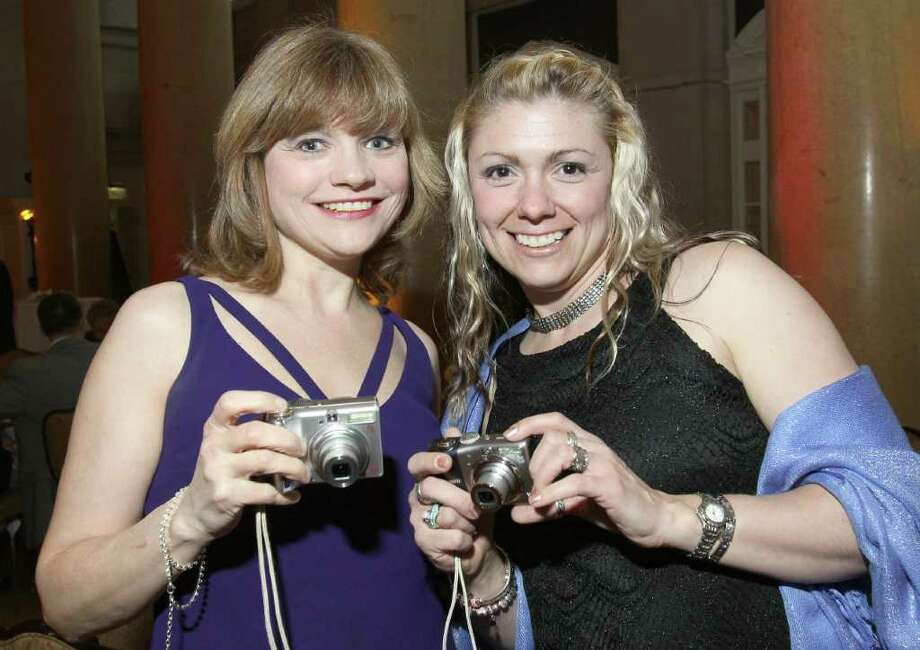 Jeanne Carras, left, and Tiffanie Fedorowicz have their cameras at the ready to snap a picture of guest celebrity host David Hyde Pierce during Through the Looking Glass: An Evening to End Alzheimer's, a gala to benefit the Alzheimer's Association of Northeastern New York in Saratoga Springs on May 5, 2011. (Photo by Joe Putrock / Special to the Times Union) Photo: Joe Putrock / Joe Putrock