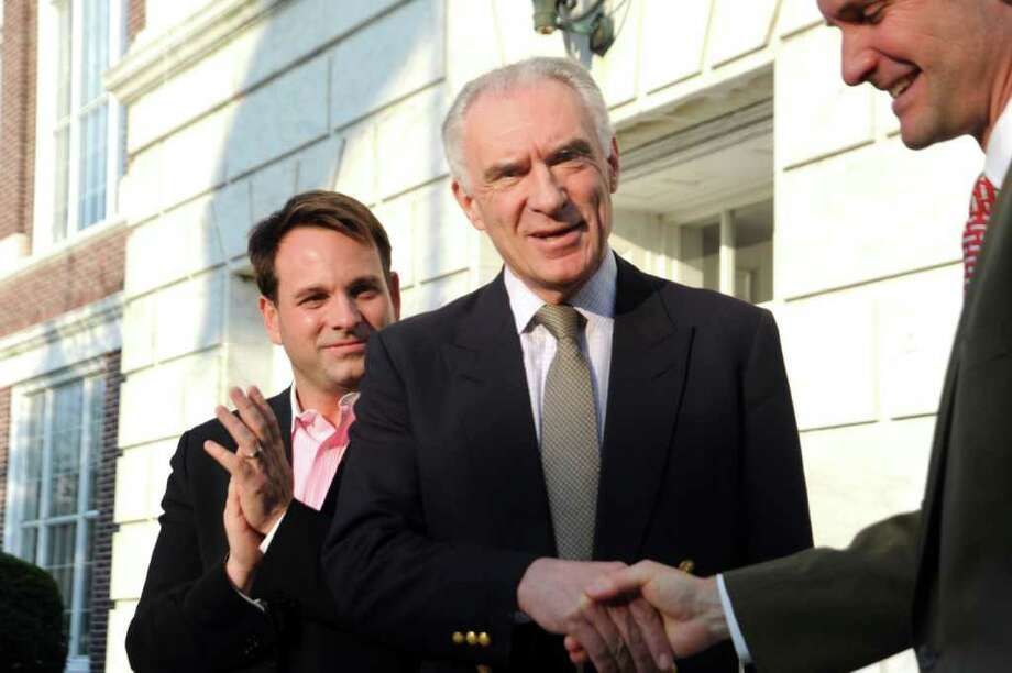 Democrat John Blankley shakes hands with U.S. Rep. Jim Himes, D-Conn., after announcing he will run for first selectman on April 25, 2011. Selectman Drew Marzullo, at left, applauds. Photo: File Photo / Greenwich Time File Photo