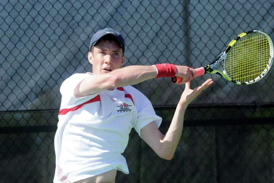 New Canaan's Chase Urban in action as New Canaan High School hosts Staples in a boys tennis match in New Canaan, Conn., May 12, 2011.  Urban played Staples' Dan Hirschberg. Photo: Keelin Daly / Stamford Advocate