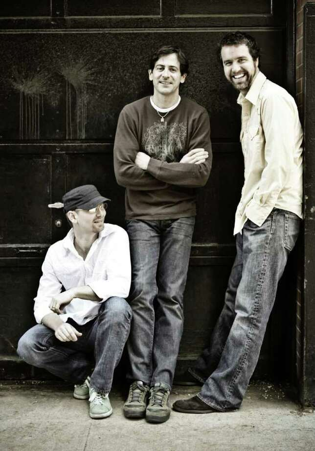 Pictured are the members of The Sweet Remains, an acoustic folk-rock trio scheduled to play the Fairfield Theatre Company's StageOne venue in downtown Fairfield on May 21. From left to rigt are Rich Price, Greg Naughton (former Westport and Weston resident) and Brian Chartrand. Photo: Contributed Photo / Westport News