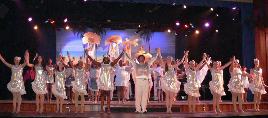 "Student performers on stage last year during the finale of ""Follies 2010 Don't Stop Believin'"" musical at Bunnell High School. This year's show, ""It's Time to Stand Up!,"" includes students from schools in 16 area towns, including Fairfield, Westport and Weston. Photo: Contributed Photo"