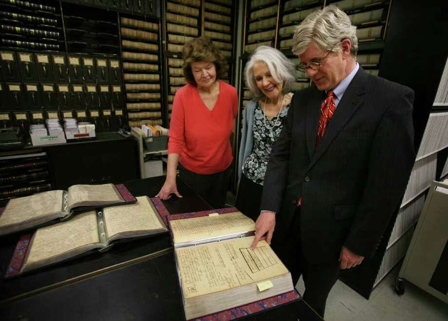From left; Clerk Bonnie Parks, Chief Clerk Sally Mackenzie, and Judge Dan Caruso look at court records from 1766 showing the repeal of the Stamp Act, in the records room of the Fairfield Probate Court on Thursday, May 12, 2011. The Stamp Act was a form of British taxation on the colonies that was one of the ignitors of the American Revolution. The courts earliest records go back to the year 1648. Photo: Brian A. Pounds / Connecticut Post
