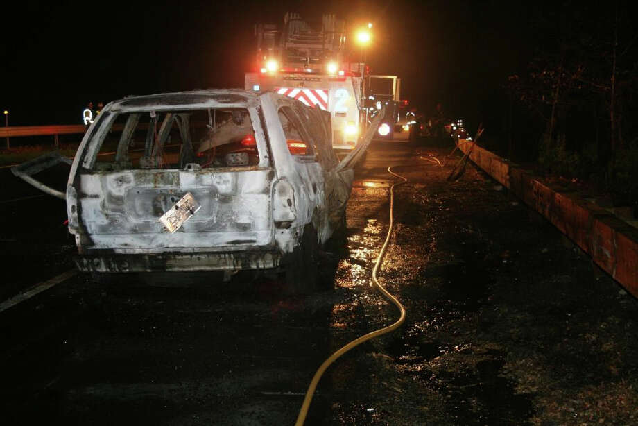 Fairfield firefighters responded late last night to a fatal car fire that resulted from a crash near exit 46 on the southbound Merritt Parkway on May 11, 2011. Photo: Contributed Photo, Contributed Photo/Fairfield Fire Department / Connecticut Post Contributed
