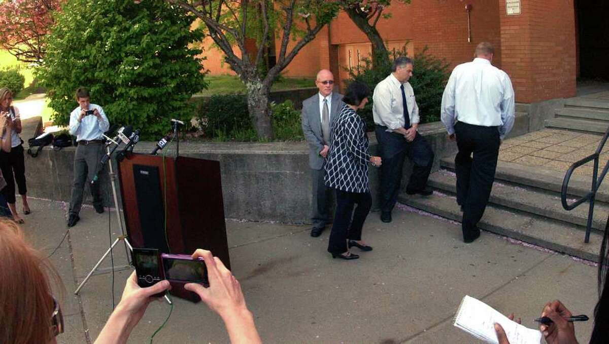 School officials, including Headmaster Dr. Beth A. Smith, hastily walk away from the media after speaking to them about the suspension of student James Tate from Shelton High School in Shelton, Conn. on Thursday May 12, 2011.