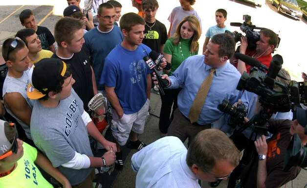 Students from the lacrosse team talk to the media outside Shelton High School in Shelton, Conn. on Thursday May 12, 2011. The team members were on hand to show their support for fellow student James Tate, who was suspended for hanging a sign on the school walls asking a friend to the prom. Photo: Christian Abraham / Connecticut Post