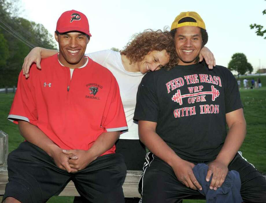 Kevin Maxen, 18, left, and twin brother, Willie, pose for a photo with their mother, Heather, 41. Photo taken Thursday, May 12, 2011. Photo: Carol Kaliff / The News-Times