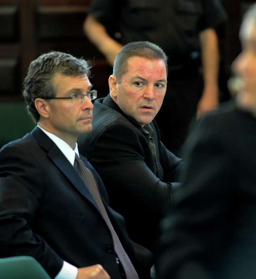 Michael Mosley, right,  sits in the courtroom in the Rensselaer County Courthouse in Troy, N.Y. during his murder trial May 9, 2011.    (Skip Dickstein / Times Union) Photo: SKIP DICKSTEIN / 00013077A
