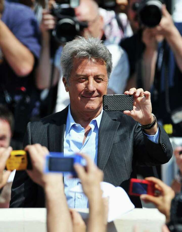 Actor Dustin Hoffman takes a photo as he attends the 'Kung Fu Panda 2' photocall during the 64th Annual Cannes Film Festival at the Carlton Hotel on May 12, 2011 in Cannes, France.  (Photo by Francois Durand/Getty Images) *** Local Caption *** Dustin Hoffman; Photo: Getty Images