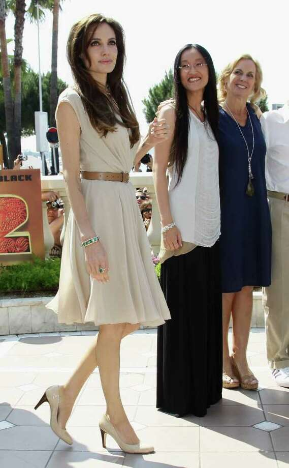 (L-R) Actress Angelina Jolie, Director Jennifer Yuh Nelson, and producer Melissa Cobb attend the 'Kung Fu Panda 2' photocall during the 64th Annual Cannes Film Festival at the Carlton Hotel on May 12, 2011 in Cannes, France.  (Photo by Vittorio Zunino Celotto/Getty Images) *** Local Caption *** Angelina Jolie;Jennifer Yuh Nelson;Melissa Cobb; Photo: Getty Images