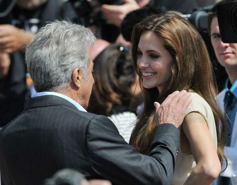 (L-R) Actors Dustin Hoffman and Angelina Jolie attend the 'Kung Fu Panda 2' photocall during the 64th Annual Cannes Film Festival at the Carlton Hotel on May 12, 2011 in Cannes, France.  (Photo by Francois Durand/Getty Images) *** Local Caption *** Angelina Jolie;Jack Black; Photo: Getty Images
