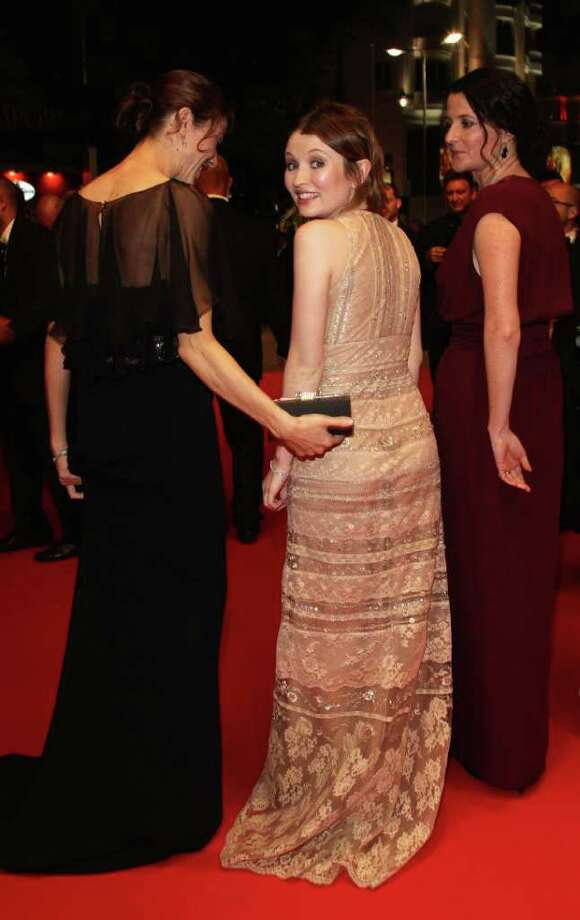 Actress Emily Browning (C) turns as she departs with producer Jessica Brentnall (L) and Director Julia Leigh after the 'Sleeping Beauty' premiere during the 64th Annual Cannes Film Festival at the Palais des Festivals on May 12, 2011 in Cannes, France.  (Photo by Andreas Rentz/Getty Images) *** Local Caption *** Emily Browning;Jessica Brentnall;Julia Leigh; Photo: Getty Images