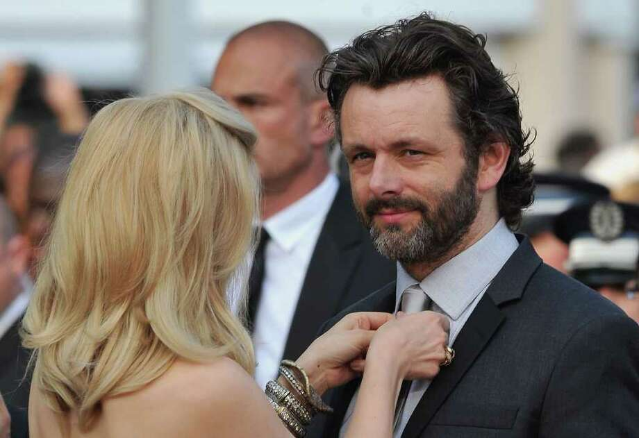 Rachel McAdams adjusts the tie of Michael Sheen at the 'Sleeping Beauty' premiere during the 64th Annual Cannes Film Festival at the Palais des Festivals on May 12, 2011 in Cannes, France.  (Photo by Pascal Le Segretain/Getty Images) *** Local Caption *** Rachel McAdams;Michael Sheen; Photo: Getty Images