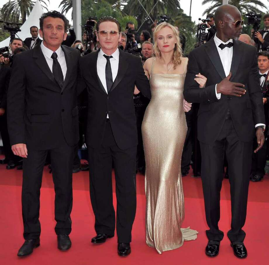 (2nd L-R)   Actors Benoit Magimel,actress Diane Kruger,Djimon Hounsou arrive at the 'Sleeping Beauty' premiere during the 64th Annual Cannes Film Festival at the Palais des Festivals on May 12, 2011 in Cannes, France.  (Photo by Pascal Le Segretain/Getty Images) *** Local Caption *** Benoit Magimel;Diane Kruger;Djimon Hounsou; Photo: Getty Images