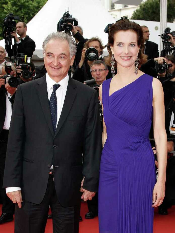 French economist Jacques Attali and French actress Carole Bouquet  arrives at the 'Sleeping Beauty' premiere during the 64th Annual Cannes Film Festival at the Palais des Festivals on May 12, 2011 in Cannes, France.  (Photo by Andreas Rentz/Getty Images) *** Local Caption *** Jacques Attali;Carole Bouquet; Photo: Getty Images