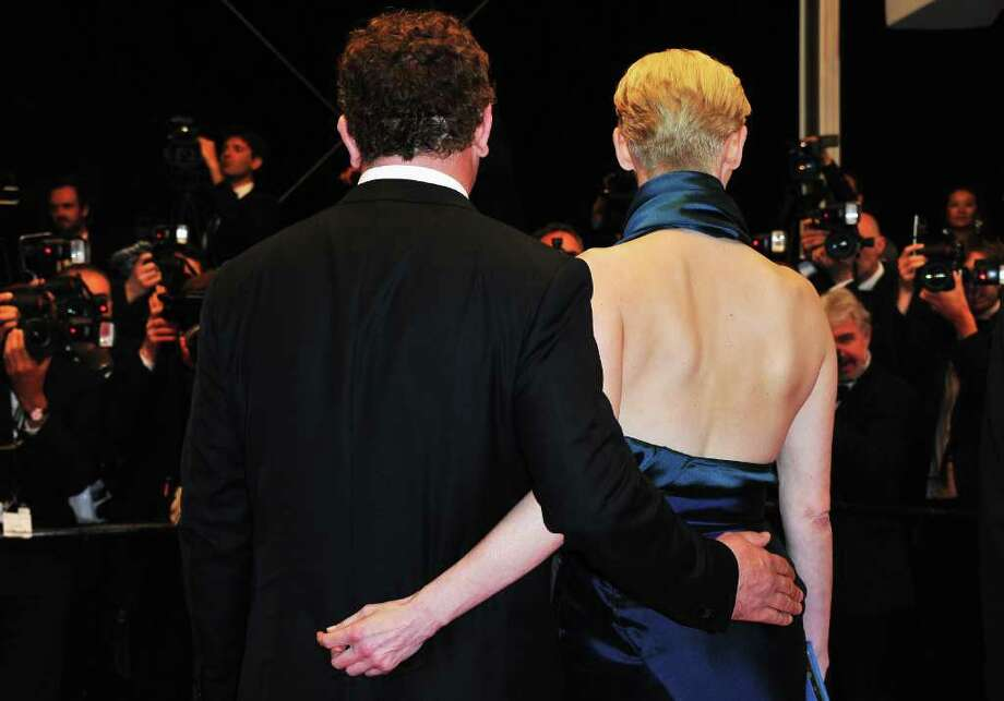 (L-R) Actor John C. Reilly and actress Tilda Swinton arrive at the 'We Need To Talk About Kevin' Premiere during the 64th Annual Cannes Film Festival at the Palais des Festivals on May 12, 2011 in Cannes, France.  (Photo by Pascal Le Segretain/Getty Images) *** Local Caption *** John C. Reilly;Tilda Swinton; Photo: Getty Images