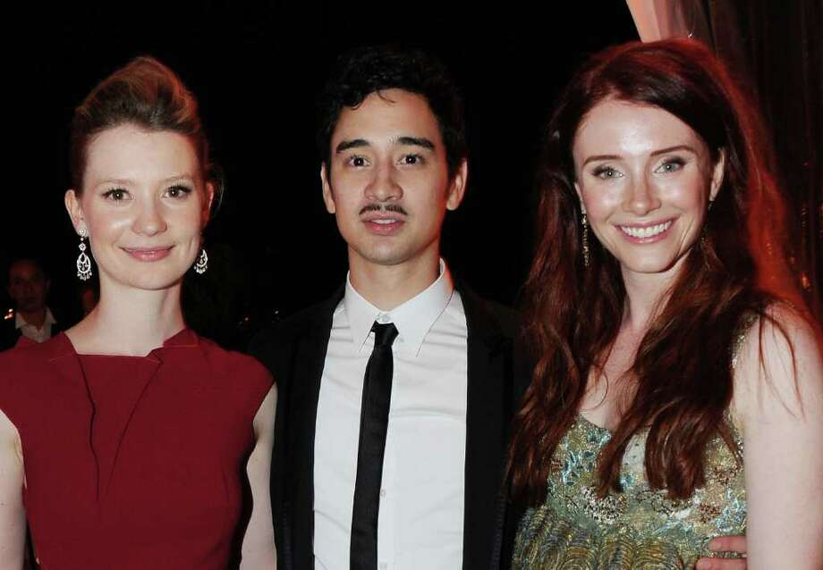 "(L-R) Actress Mia Wasikowska, writer Jason Lew and actress Bryce Dallas Howard attend the ""Restless"" dinner during the 64th Annual Cannes Film Festival at the Moet & Chandon Terrace on May 12, 2011 in Cannes, France.  (Photo by Michael Buckner/Getty Images) *** Local Caption *** Mia Wasikowska;Bryce Dallas Howard;Jason Lew; Photo: Getty Images"