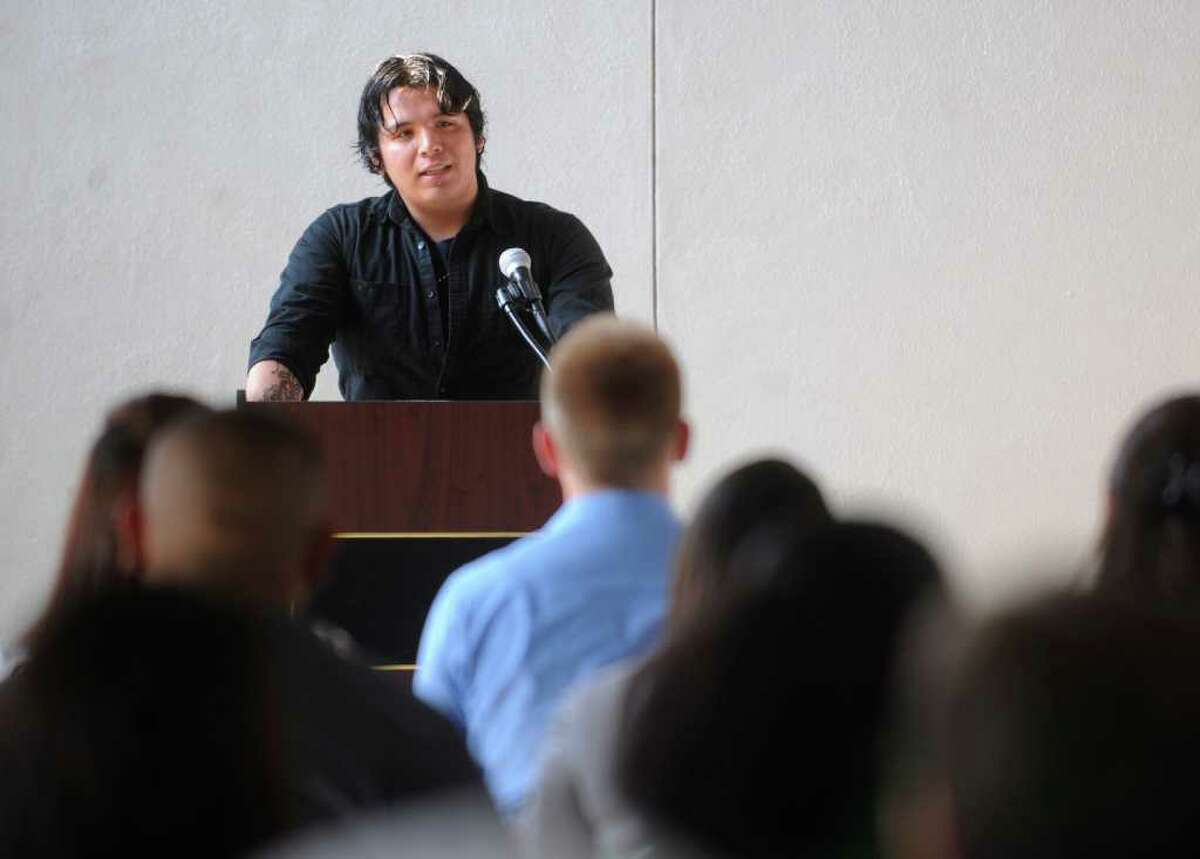 Alexander Vidales speaks during a GED ceremony at Good Samaritan Community Services on Thursday, May 12, 2011.