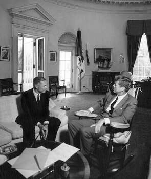 In this Aug. 15, 1963 black-and-white file photo, provided by the John F. Kennedy Presidential Library and Museum, President John F. Kennedy, right, meets with Henry Cabot Lodge Jr., the then-newly appointed Ambassador to Vietnam, in the White House Oval Office in Washington. Photo: Abbie Rowe, AP / National Park Service via JFK Library