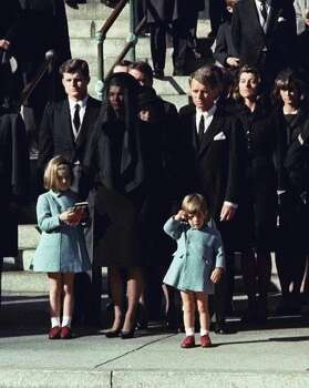 Three-year-old John F. Kennedy Jr. salutes his father's casket in Washington in this Nov. 25, 1963 file photo, three days after the president was assassinated in Dallas. Widow Jacqueline Kennedy, center, and daughter Caroline Kennedy are accompanied by the late president's brothers Sen. Edward Kennedy, left, and Attorney General Robert Kennedy. Photo: AP / AP