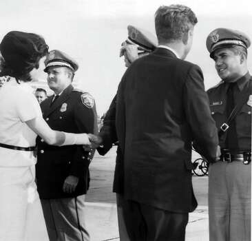 President and Mrs. John F. Kennedy in San Antonio, Texas during his visit November 21, 1963 visit. On the right shaking JFK's hand is SAPD officer Johnny Munoz. Photo: EXPRESS-NEWS ARCHIVES