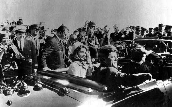 President John F. Kennedy and his wife, Jacqueline, are shown in this November 22, 1963, file photo as they leave Love Field airport in Dallas.  As the motorcade wound its way through downtown Dallas, President Kennedy was shot to death.  Texas Gov. John B. Connally, in the same limousine as Kennedy, was seriously wounded.  Lee Harvey Oswald, suspected of assassinating the president, was arrested. Photo: ASSOCIATED PRESS / EXPRESS-NEWS FILE PHOTO
