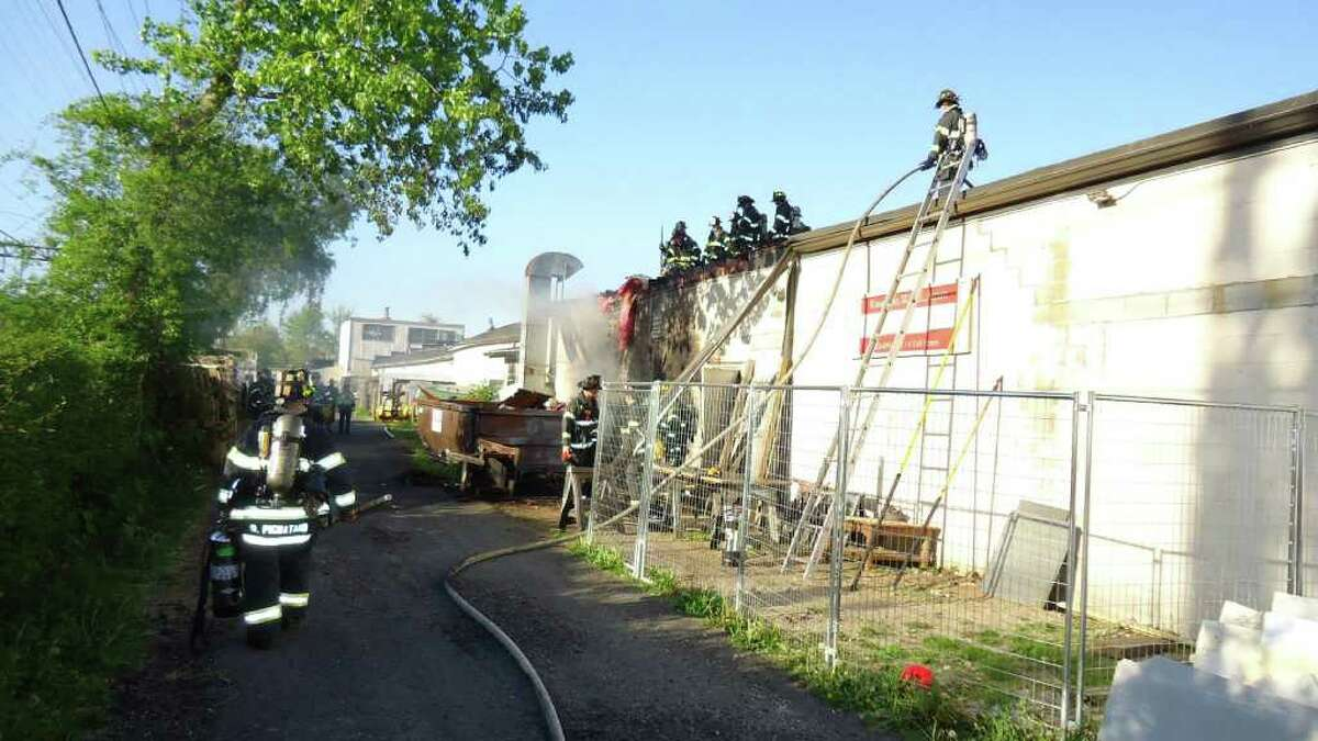 The fire at 4 Taft St., near the corner of Martin Luther King Jr. Dr., appears to have started in the area of a plastic storage shed and garbage cans along side a dumpster against the rear of Knock on Wood Antiques, Deputy Chief Edward Prescott said.