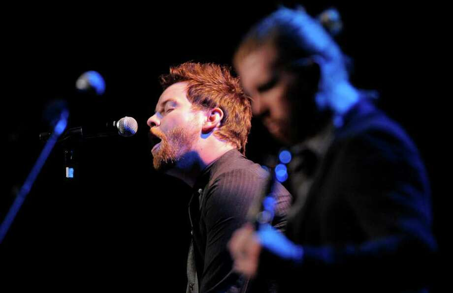 David Cook, left, performs with his band during the National Association of Recording Merchandisers Convention Awards Dinner, Thursday, May 12, 2011, in Los Angeles. Photo: AP