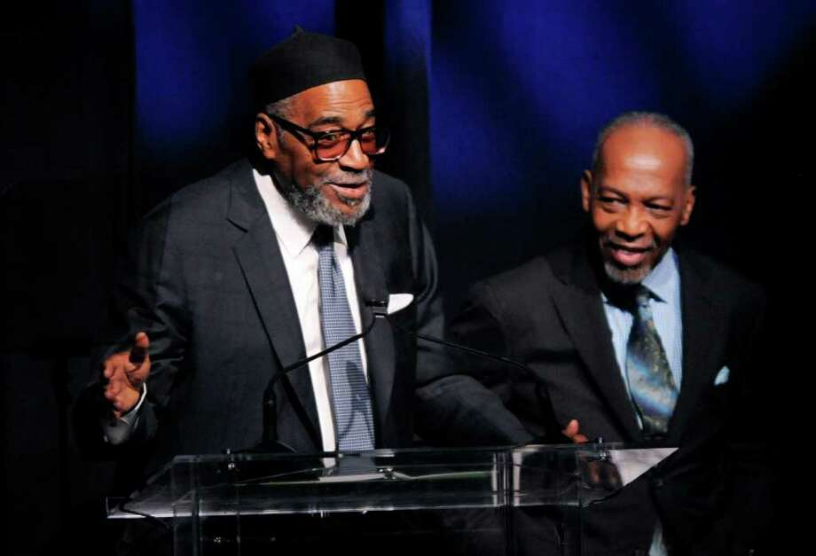 Producer-songwriting duo Kenneth Gamble, left, and Leon Huff accept the Outstanding Achievement Award for Musical Collaboration at the National Association of Recording Merchandisers Convention Awards Dinner, Thursday, May 12, 2011, in Los Angeles. Photo: AP