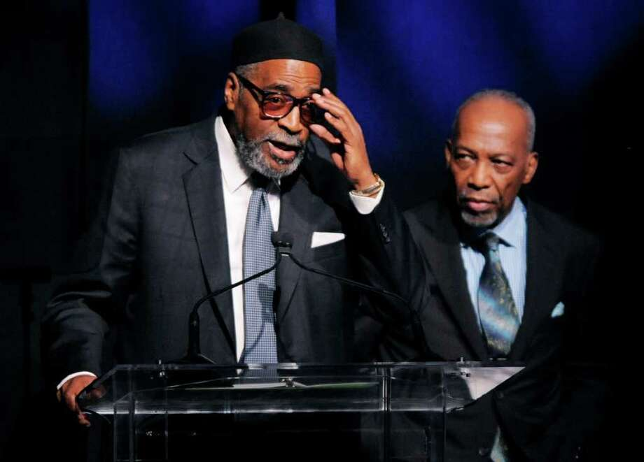 Producer-songwriting duo Kenneth Gamble, left, and Leon Huff accept the Outstanding Achievement for Musical Collaboration at the National Association of Recording Merchandisers Convention Awards Dinner, Thursday, May 12, 2011, in Los Angeles. Photo: AP