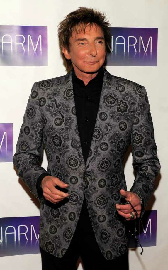 Barry Manilow arrives at the National Association of Recording Merchandisers Convention Awards Dinner, Thursday, May 12, 2011, in Los Angeles. Photo: AP