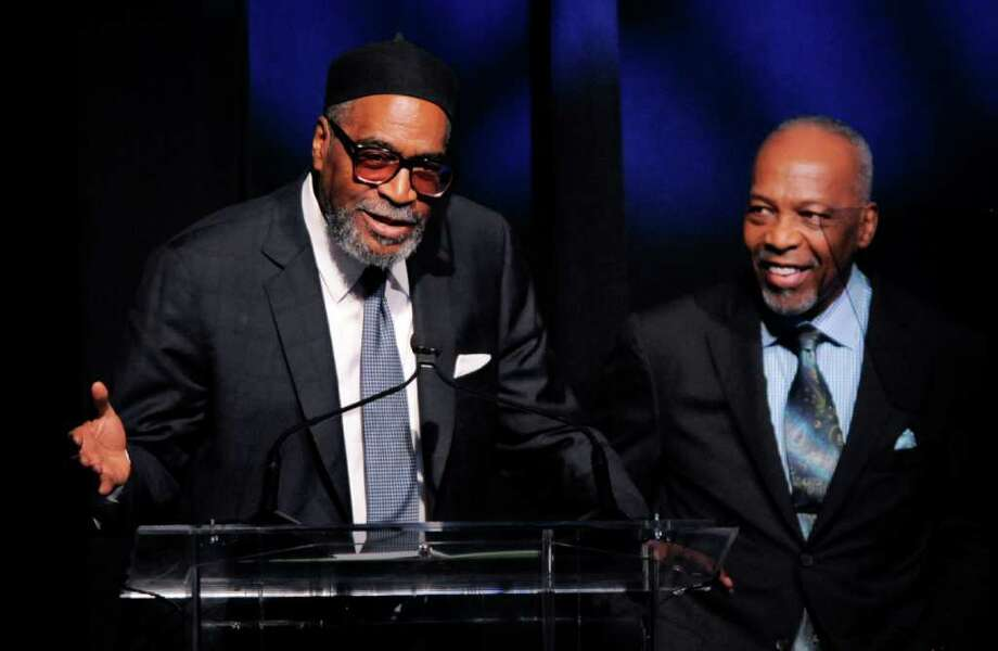 Producer-songwriter duo Kenneth Gamble, left, and Leon Huff accept the Outstanding Achievement for Musical Collaboration award at the National Association of Recording Merchandisers Convention Awards Dinner, Thursday, May 12, 2011, in Los Angeles. Photo: AP