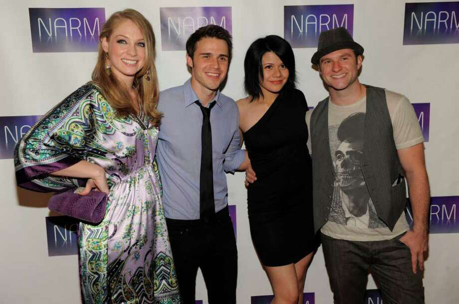 "Past ""American Idol"" performers, from left, DiDi Benami, Kris Allen, Allison Iraheta and Blake Lewis pose together at the National Association of Recording Merchandisers Convention Awards Dinner, Thursday, May 12, 2011, in Los Angeles. Photo: AP"