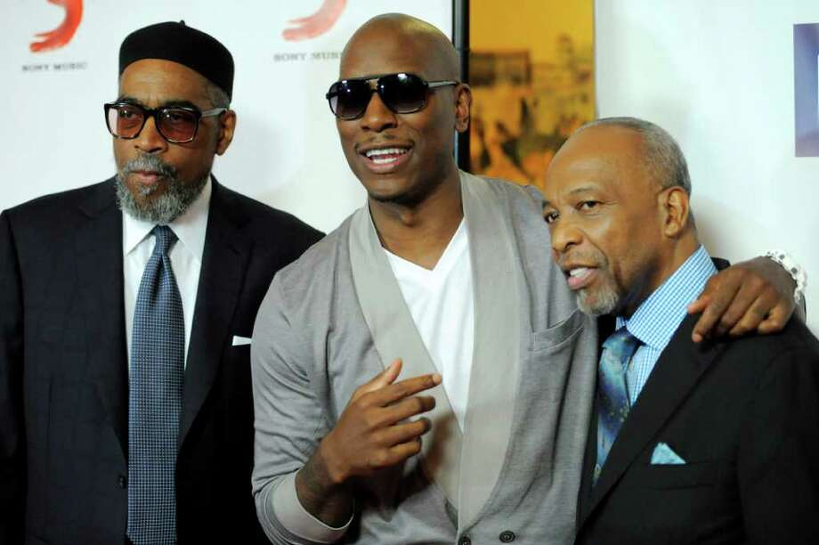 Singer Tyrese, center, poses with honorees Kenneth Gamble, left, and Leon Huff before the National Association of Recording Merchandisers Convention Awards Dinner, Thursday, May 12, 2011, in Los Angeles. Photo: AP