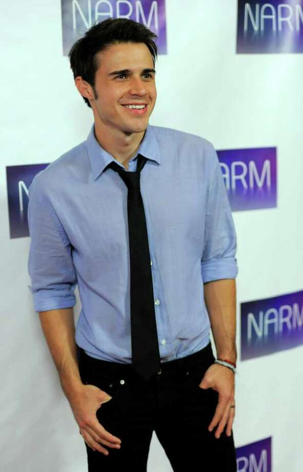 Singer Kris Allen poses at the National Association of Recording Merchandisers Convention Awards Dinner, Thursday, May 12, 2011, in Los Angeles. Photo: AP