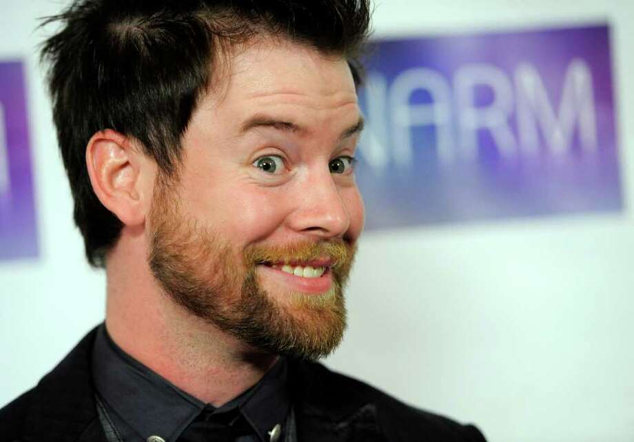 Singer David Cook poses for photographers at the National Association of Recording Merchandisers Convention Awards Dinner, Thursday, May 12, 2011, in Los Angeles. Photo: AP