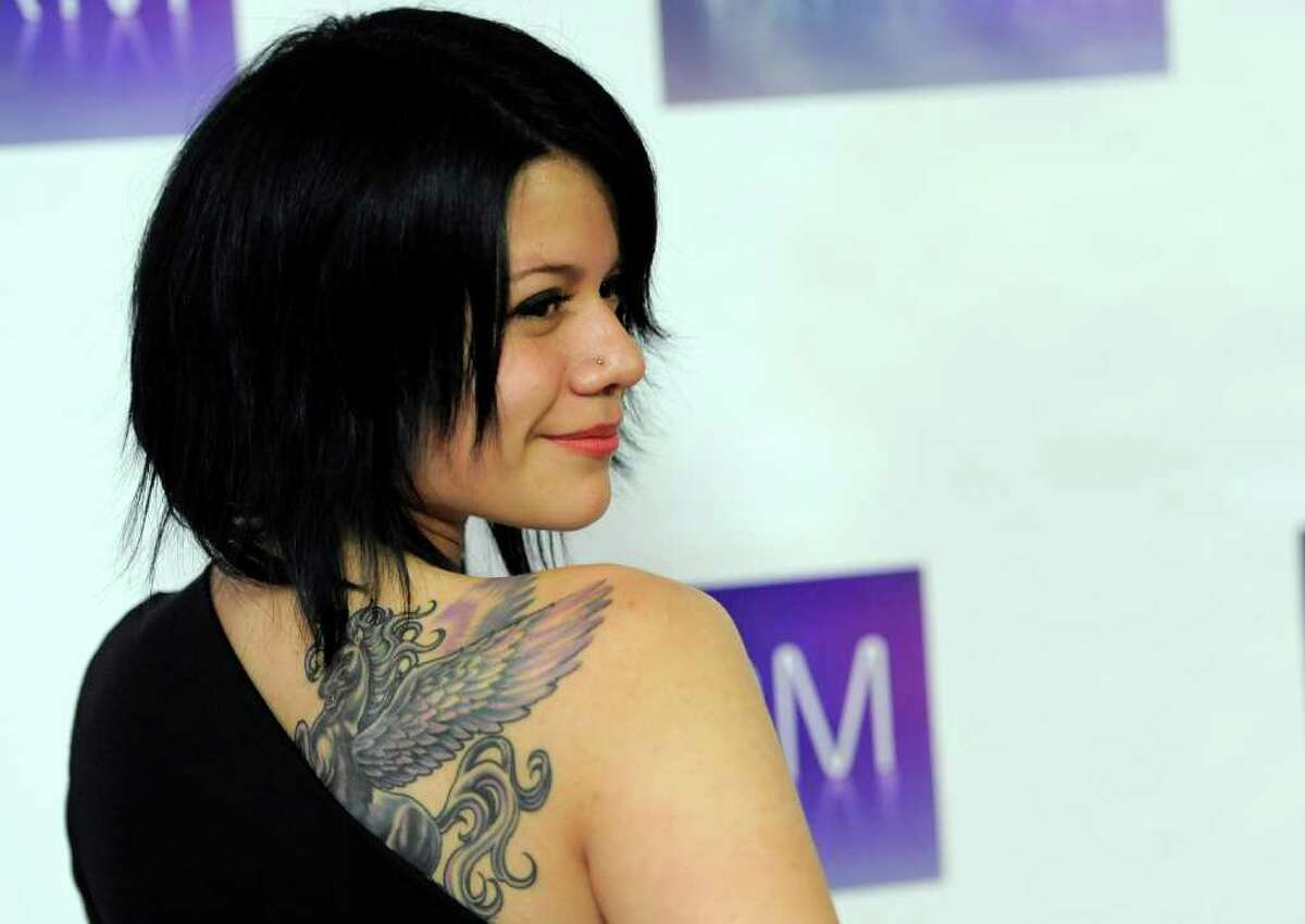 Singer Allison Iraheta turns back for photographers at the National Association of Recording Merchandisers Convention Awards Dinner, Thursday, May 12, 2011, in Los Angeles.