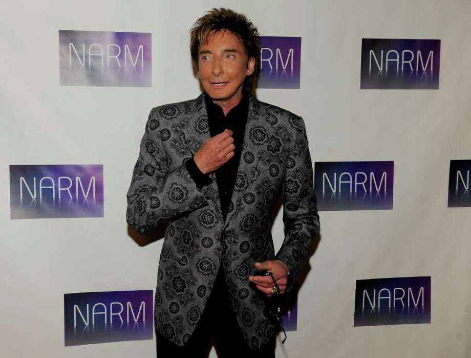 Singer Barry Manilow arrives at the National Association of Recording Merchandisers Convention Awards Dinner, Thursday, May 12, 2011, in Los Angeles. Photo: AP