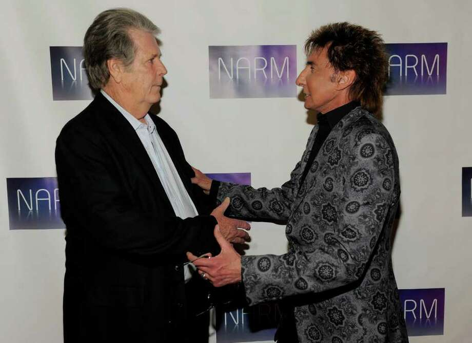 Musicians Brian Wilson, left, and Barry Manilow greet each other on the red carpet at the National Association of Recording Merchandisers Convention Awards Dinner, Thursday, May 12, 2011, in Los Angeles. Photo: AP