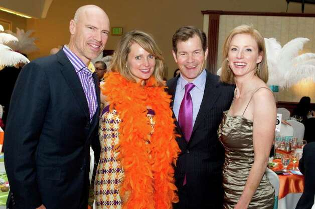 "Whitby School parent and former New York Ranger Mark Messier and his wife Kim join Whitby parent and Hockey Hall of Famer Mike Richter and his wife Veronica at the school's annual spring benefit, which was held recently at the Italian Center in Stamford. Richter served as Master of Ceremonies for the event, which had a ""Samba into Spring"" theme. Photo: Contributed Photo / Greenwich Citizen"