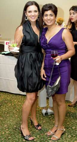 "Mari Vasan, left, and Rita Pai take a break from the silent auction at Whitby School's recent ""Samba into Spring"" benefit. Photo: Contributed Photo / Greenwich Citizen"