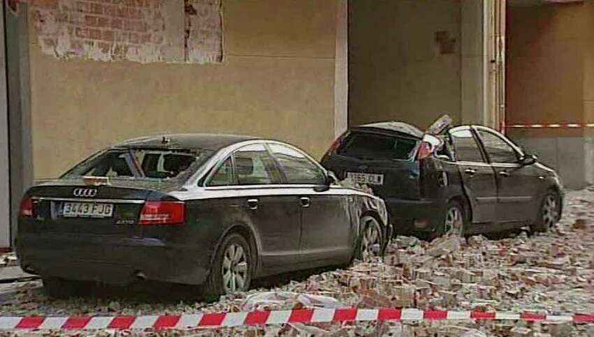 Damaged vehicles and debris are seen on the street after an earthquake in Lorca Spain in this image taken from TV Wednesday May 11, 2011. Two earthquakes struck southeast Spain in quick succession Wednesday, killing several people, and injuring dozens and causing major damage to buildings, officials said. The epicenter of the quakes with magnitudes of 4.4 and 5.2 was close to the town of Lorca, and the second came about two hours after the first. (AP Photo/Atlas TV, via APTN) TV OUT SPAIN OUT