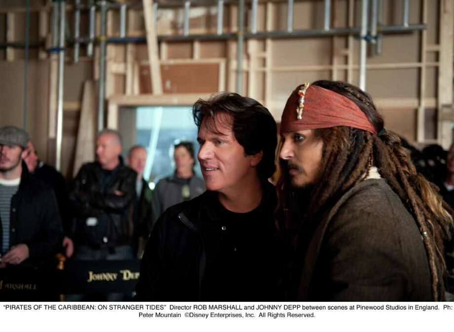 Director ROB MARSHALL and JOHNNY DEPP between scenes at Pinewood Studios in England. Ph: Peter Mountain  Disney Enterprises, Inc. All Rights Reserved. Photo: Peter Mountain  Disney / ©Disney Enterprises, Inc. All Rights Reserved.