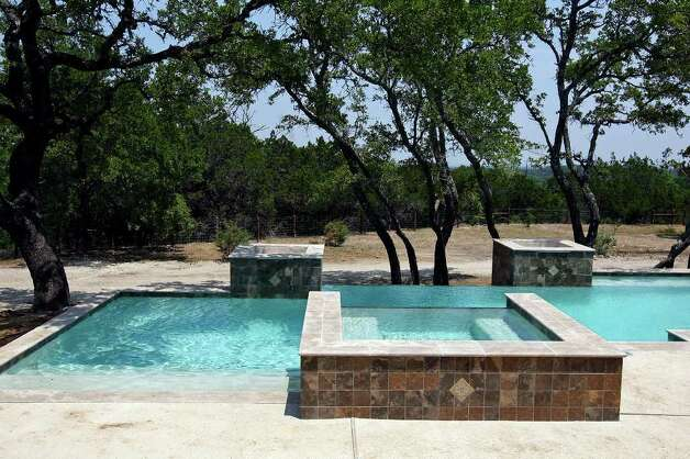 FOR REAL ESTATE - A view of the pool at 341 Menger Springs a Trinity Custom Builders home Monday May 9, 2011 in the Menger Springs community of Boerne, Tx. (PHOTO BY EDWARD A. ORNELAS/eaornelas@express-news.net) Photo: EDWARD A. ORNELAS, SAN ANTONIO EXPRESS-NEWS / SAN ANTONIO EXPRESS-NEWS (NFS)
