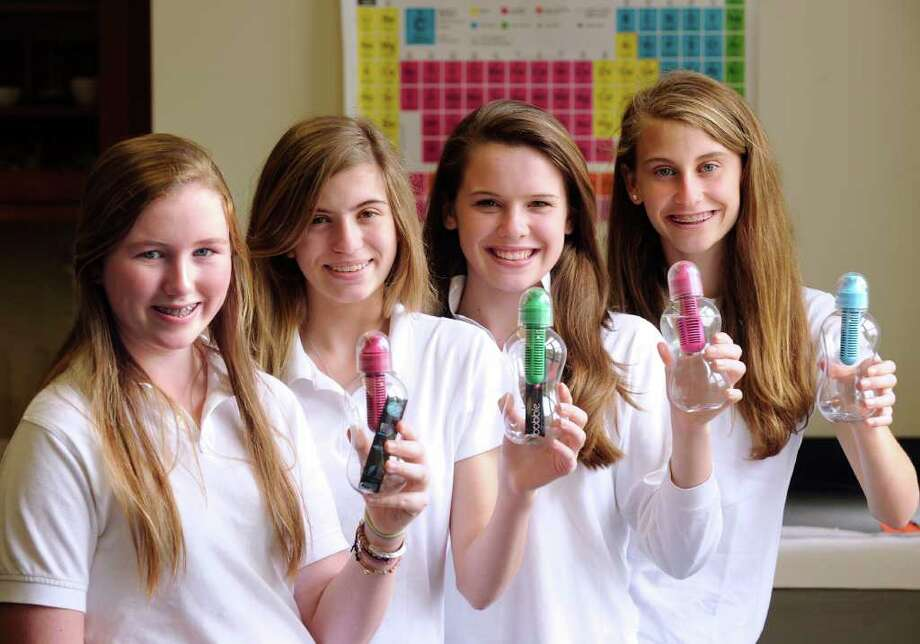 "Convent of the Sacred Heart eighth graders from left, Ailish Cunniffe, 14, Isabella Libassi, 14, Claren Hesburgh, 14 and Grace Isford, 14, hold their reusable filtered water bottles, called Bobbles, at Convent of the Sacred Heart School, Greenwich, 13, 2011.  The four students won the state championship in the Seimens ""We Can Change the World"" environmental challenge by creating a water conservation project and education program for their school. Photo: Bob Luckey / Greenwich Time"